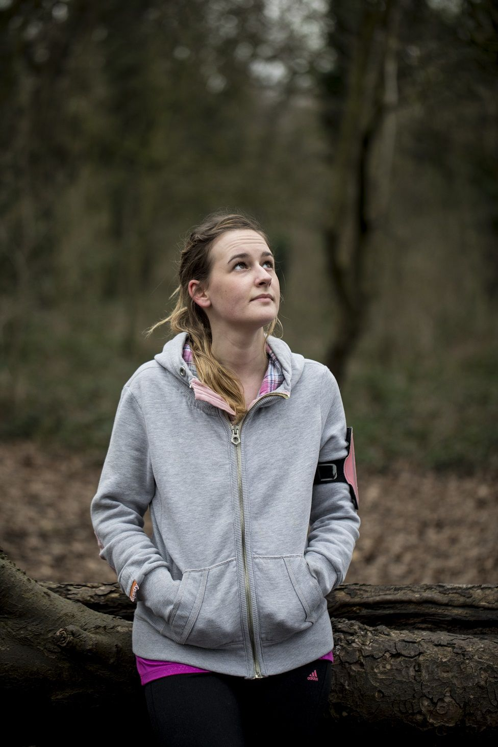 Photo of Beth Lackenby on a woodland trail in running gear
