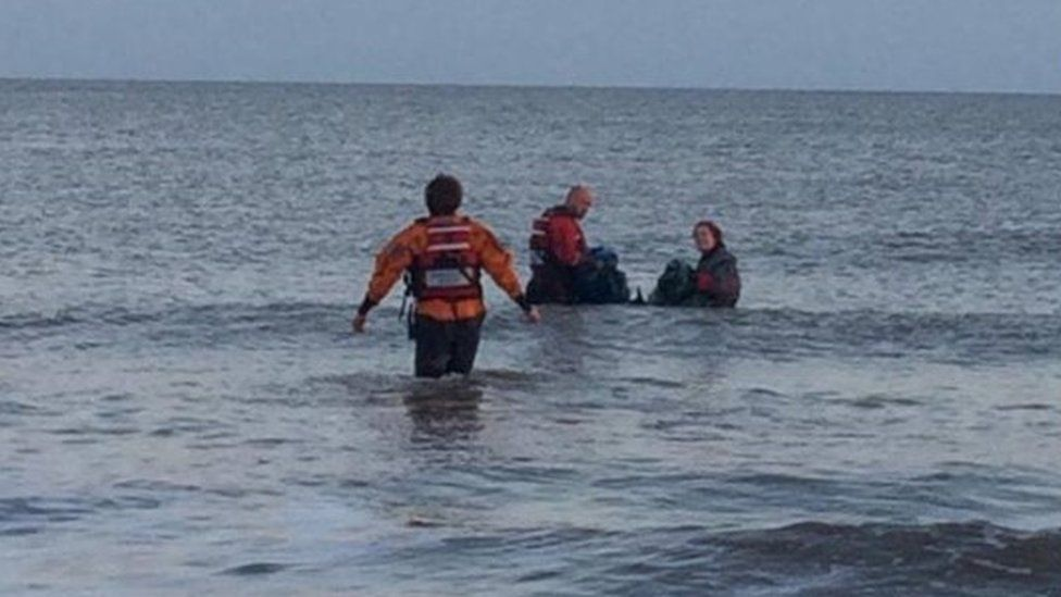 Divers and the coastguard rescuing the porpoise on Saturday