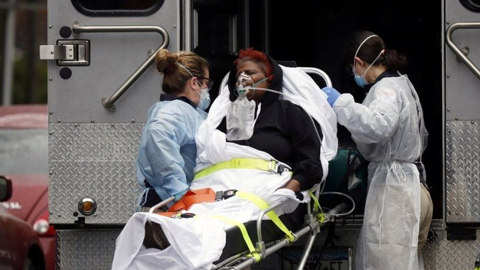 Medics bring a sick patient to an ambulance in New York City. Photo: 28 March 2020