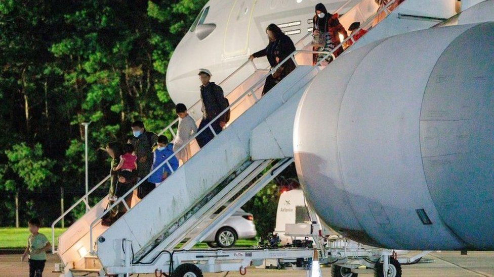 British nationals and Afghan evacuees depart a flight from Afghanistan at RAF Brize Norton on 17 August 2021