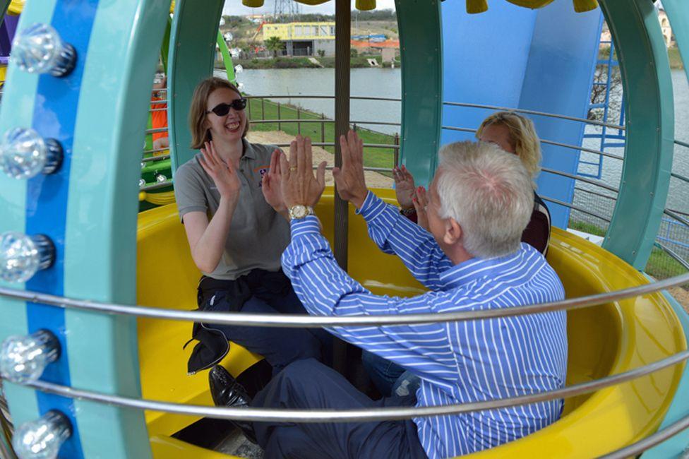 Morgan and her parents enjoying the Ferris wheel at Morgan's Wonderland