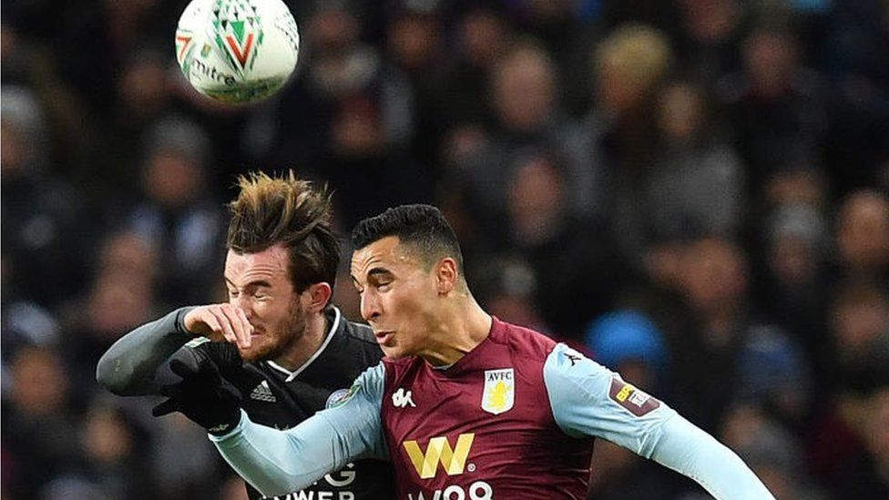 Leicester City's English defender Ben Chilwell (L) vies in the air to header the ball with Aston Villa's Dutch striker Anwar El Ghazi during the English League Cup semi-final second leg football match between Aston Villa and Leicester City at Villa Park in Birmingham, central England on January 28, 2020.