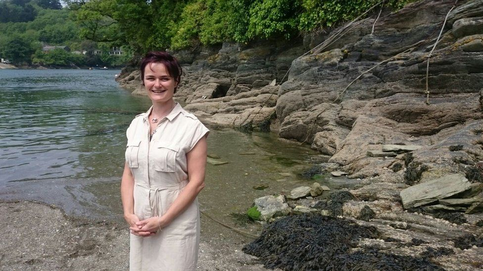 Dr Joanie Willett standing by a lake