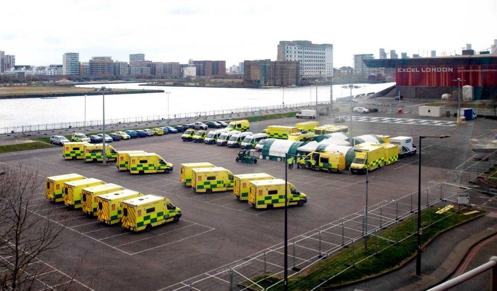 Ambulances seen parked outside the NHS Nightingale Hospital