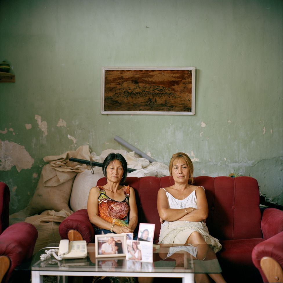 Sisters Olga and Adelina Lim Hi, one of the few Korean descendants in Cuba who do not have mixed heritage.