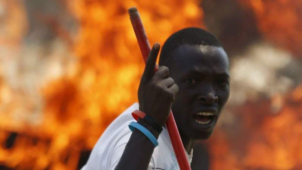 A protester in Burundi angered at President Pierre Nkurunziza's decision to run for a third term