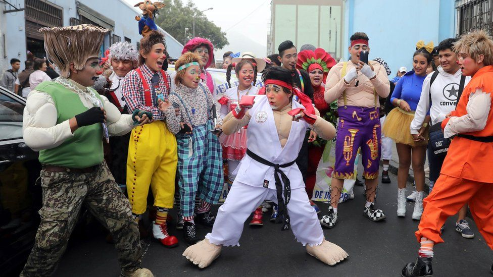 Clowns take part in a parade during Peru's Clown Day celebrations in Lima, Peru May 25, 2018