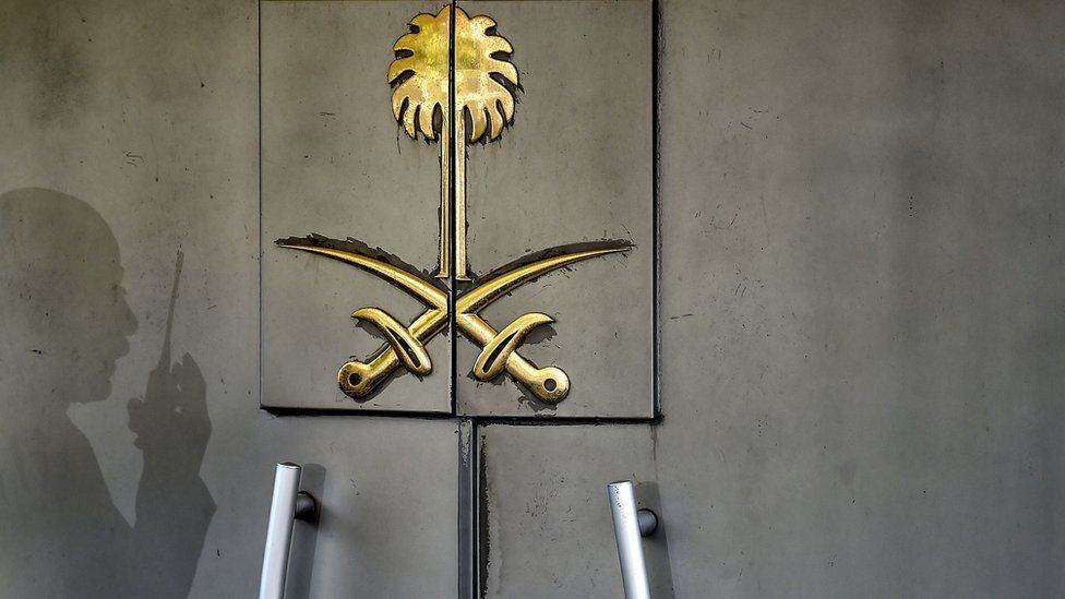 The shadow of a security member of the consulate is seen on the door of the Saudi Arabian consulate on 1 November 2018 in Istanbul