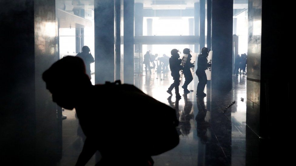 Demonstrators and police clash inside the National Assembly building, in Quito, Ecuador, October 8, 2019