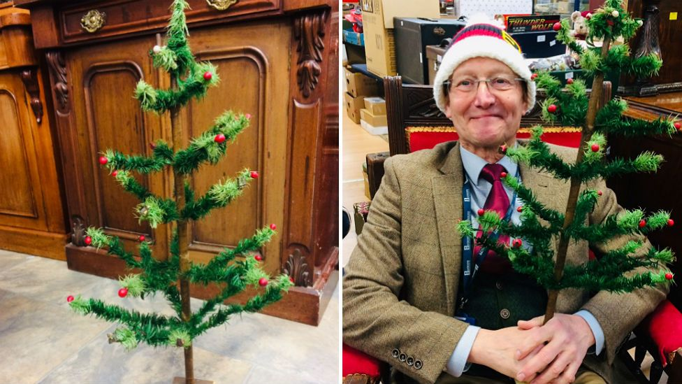 Staff member Adrian Kinton with the tree