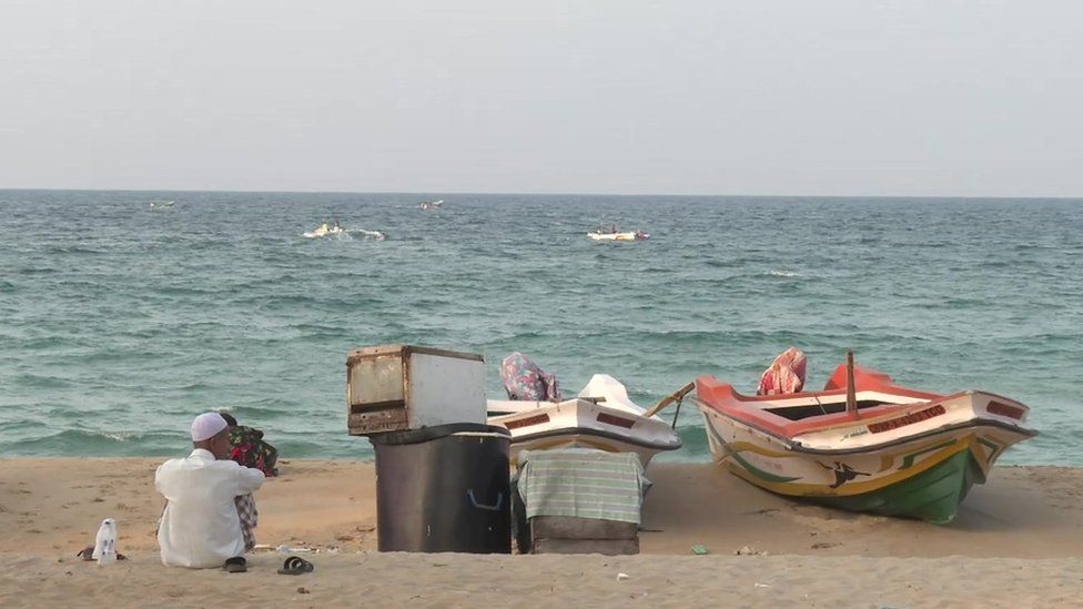 Fisherman sits on the beach in Kattankudy