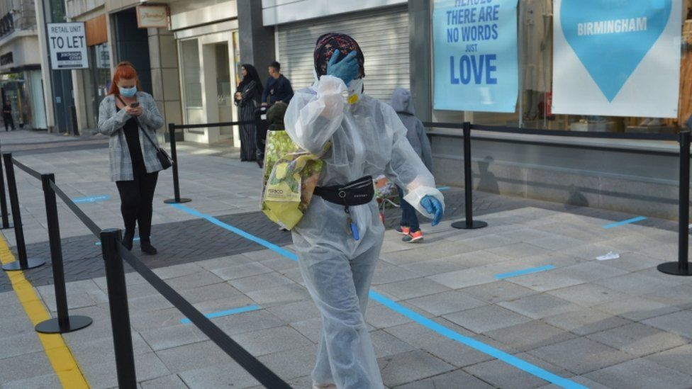 A customer dressed in PPE