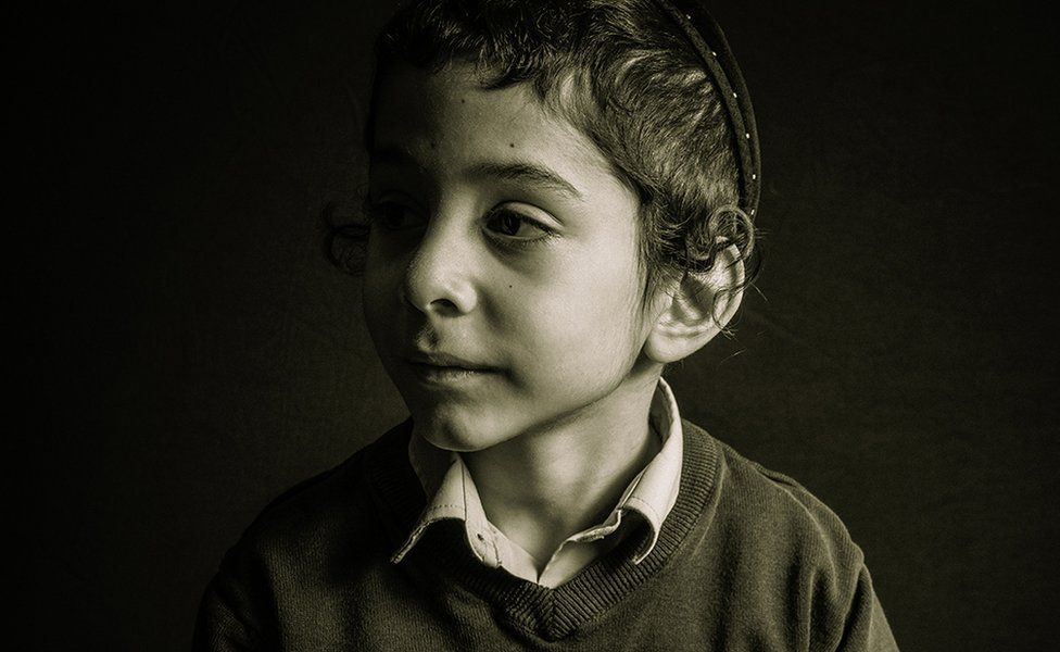 A photo of a boy named Eli - voted third in Advanced Open Print