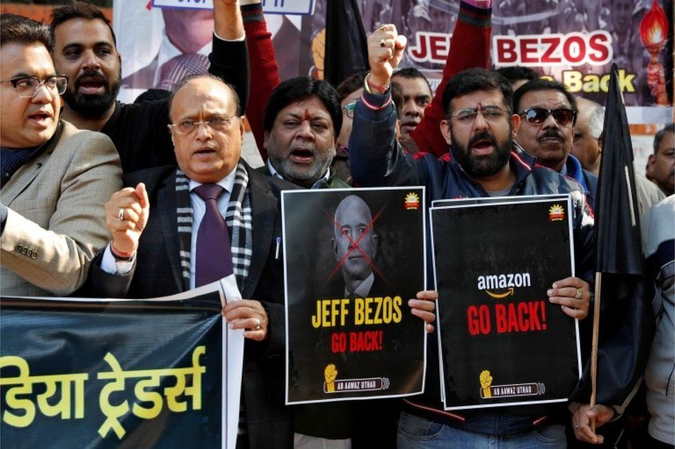 Members of the Confederation of All India Traders (CAIT) hold placards and shout slogans during a protest against the visit of Jeff Bezos, founder of Amazon, to India, in New Delhi, India, January 15, 2020.