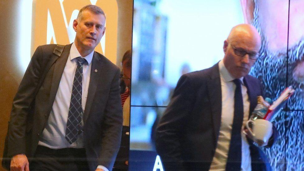 John Lyons, ABC's executive editor, and an Australian police officer