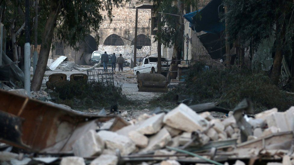 Rubble and abandoned furniture in the streets of eastern Aleppo