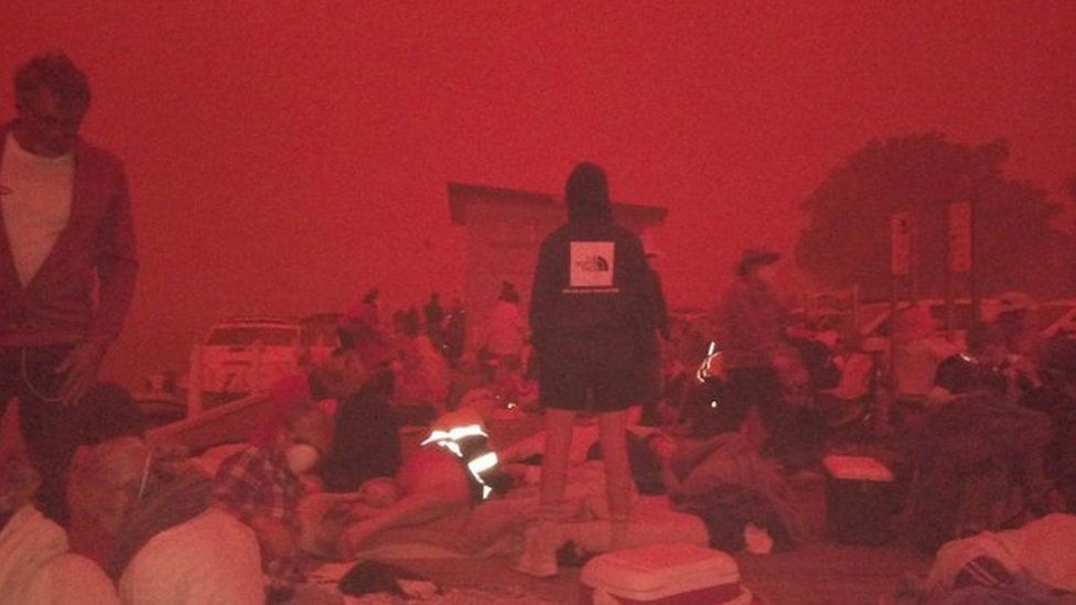 People in Mallacoota evacuated to the beaches under a deep-red sky