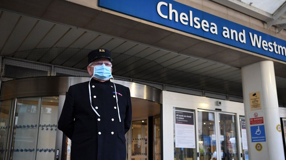 "A veteran wearing a Royal Hospital Chelsea hat, and in PPE (personal protective equipment) of a face mask, as a precautionary measure against COVID-19, pauses for a minute""s silence to honour UK key workers, including Britain""s NHS (National Health Service) staff, health and social care workers, who have died during the coronavirus outbreak outside the Chelsea and Westminster Hospital in London"