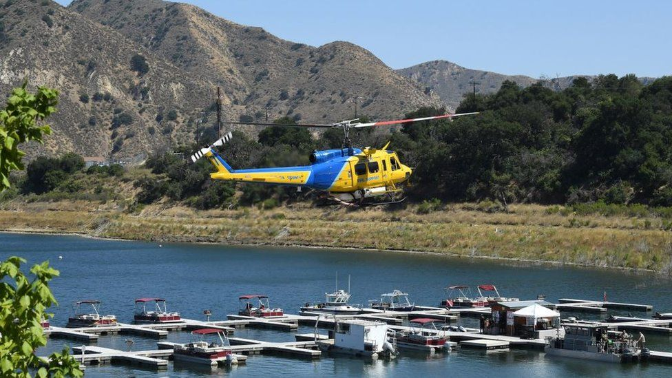 A Ventura County Sheriff's helicopter returns to base as amid the search
