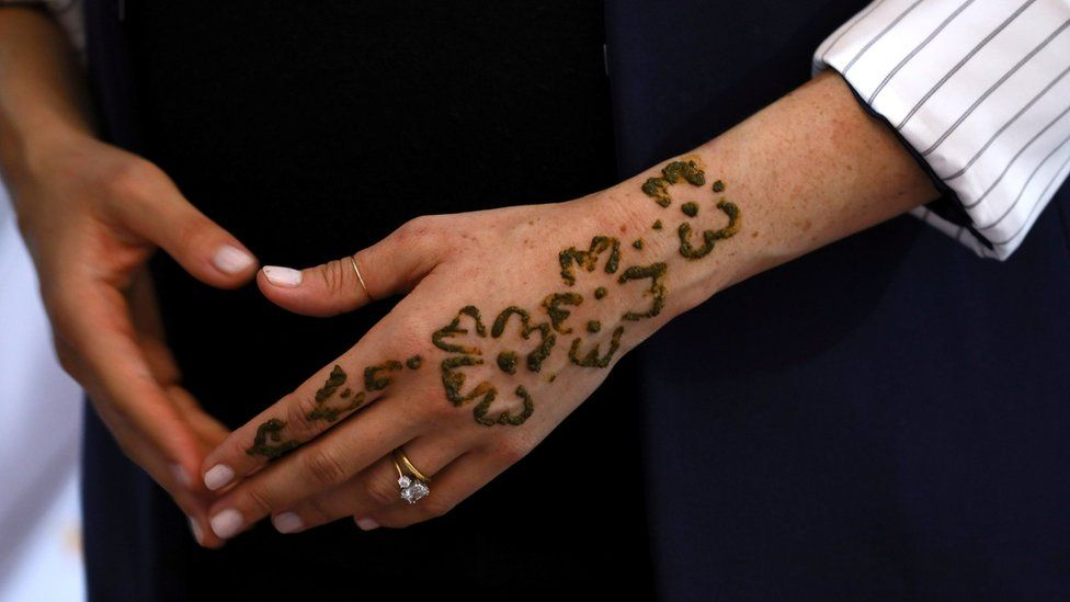 The Duchess of Sussex's hand with henna applied