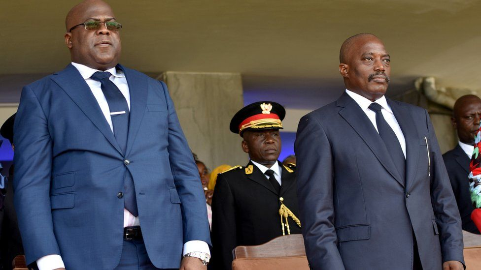 "FILE PHOTO: Democratic Republic of Congo""s outgoing President Joseph Kabila and his successor Felix Tshisekedi stand during an inauguration ceremony in Kinshasa, Democratic Republic of Congo, January 24, 2019"
