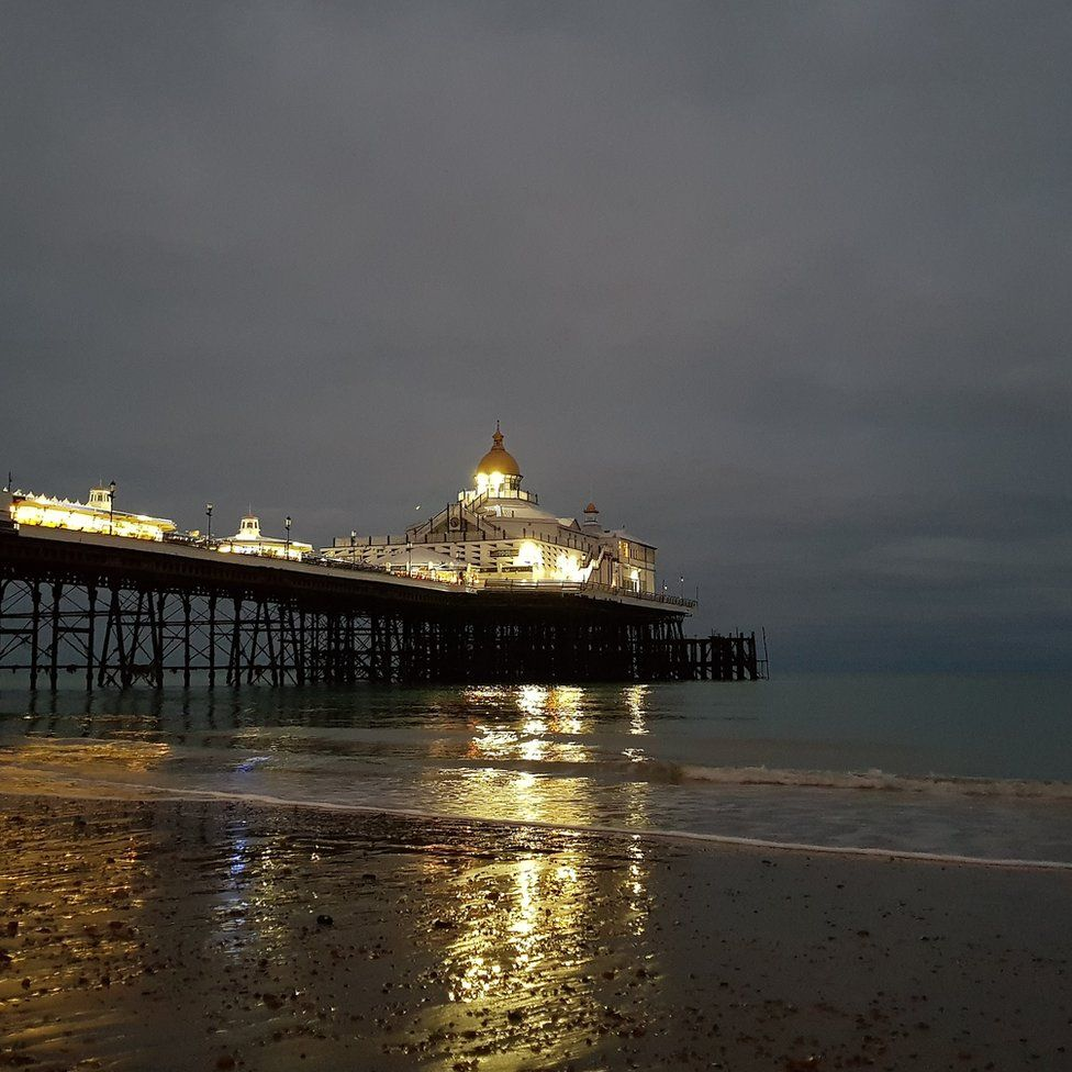 Reflections of a pier in the sea