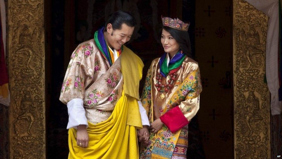 This Oct. 13, 2011 file photo Queen Jetsun Pema, right, looks at King Jigme Khesar Namgyal Wangchuck as they pose after they were married