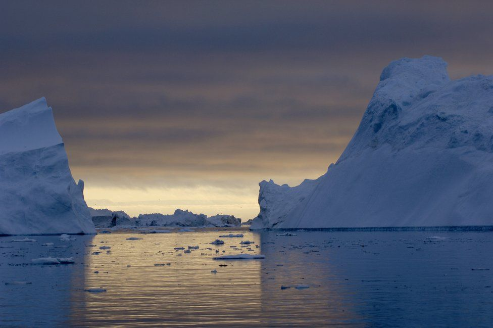 The midnight sun on an ice floe near Greenland