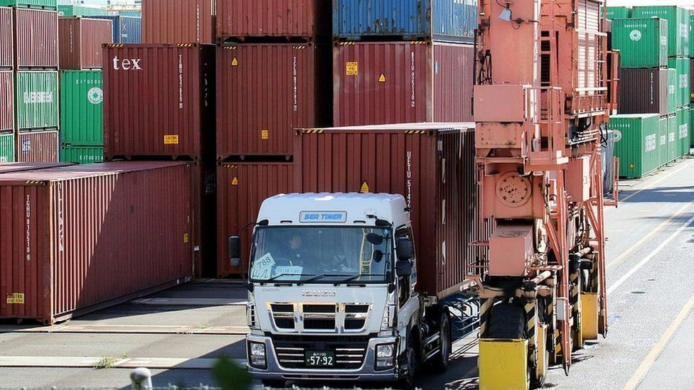 A truck leaves Tokyo's international cargo terminal