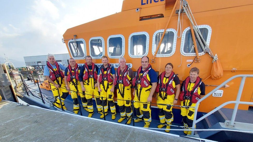 Fenit RNLI crew in front of their boat