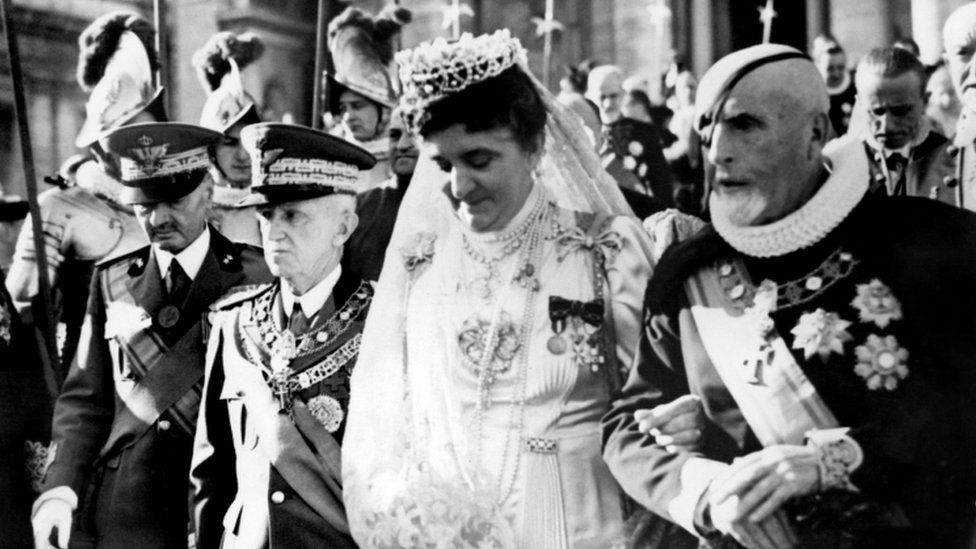 Queen Elena of Italy (second right) and King Victor Emmanuel III (second left) leave Vatican city after an official visit to Pope Pie XII on December 26, 1939