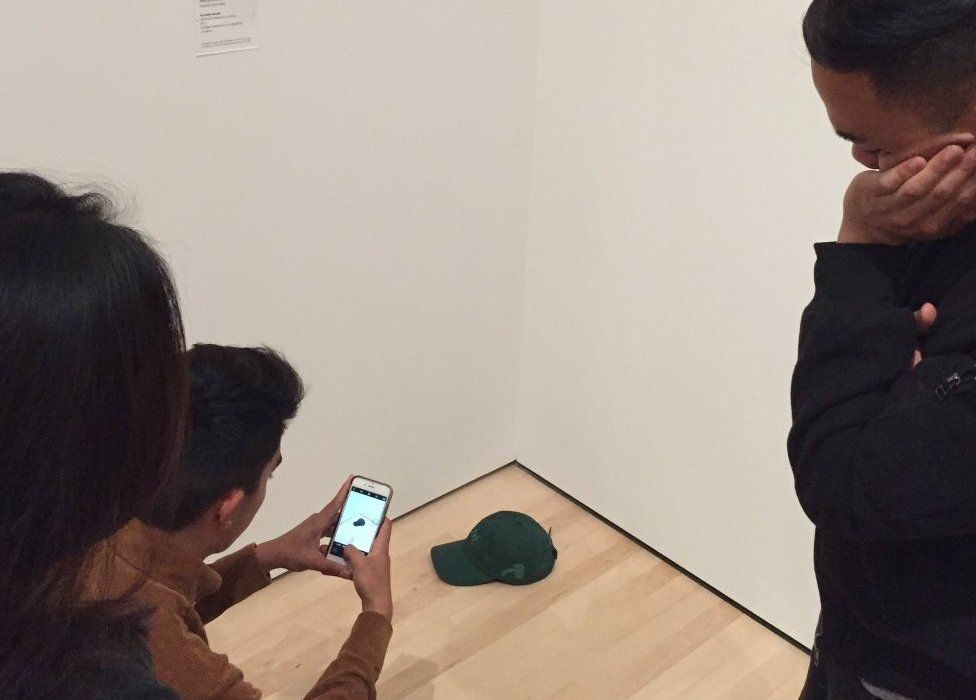 A baseball cap on the floor of the gallery