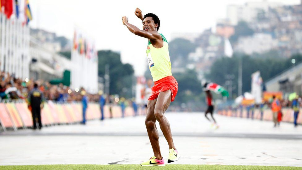 "Feyisa Lilesa of Ethiopia celebrates while crossing the finish line to take the second place in the men""s Marathon race of the Rio 2016 Olympic Games Athletics, Track and Field events at the Sambodromo in Rio de Janeiro, Brazil, 21 August 2016."