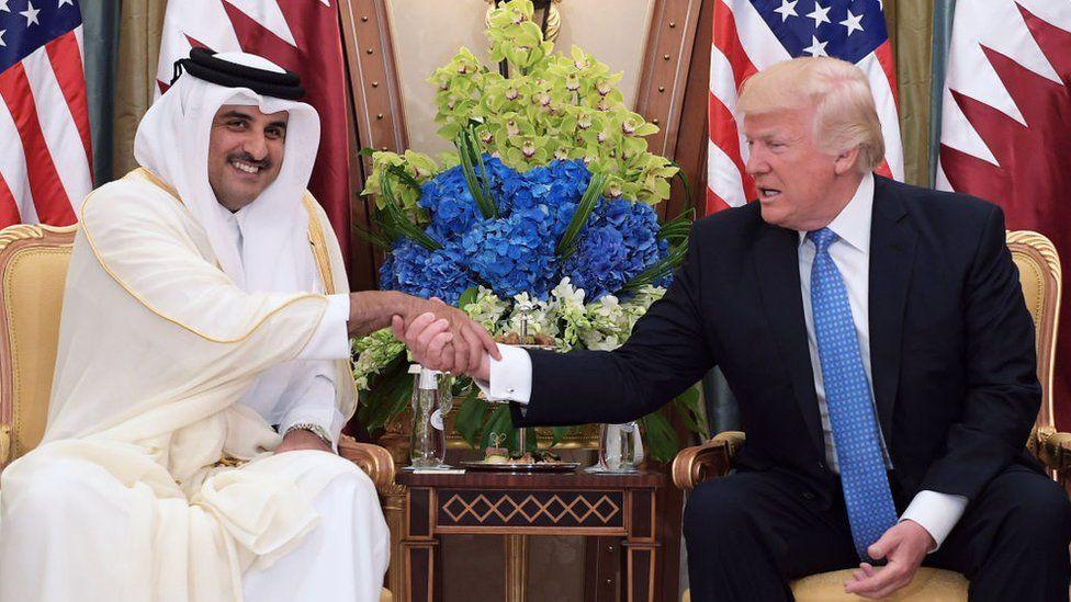 US President Donald Trump (R) and Qatar's Emir Sheikh Tamim Bin Hamad Al-Thani take part in a bilateral meeting at a hotel in Riyadh in May 2017
