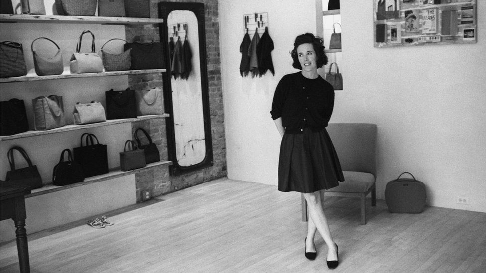 Kate Spade in her first handbag shop in black and white photograph from 1996