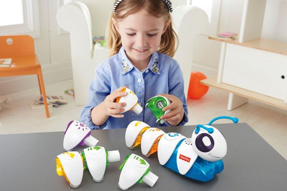 Young girl playing with Code-a-pillar