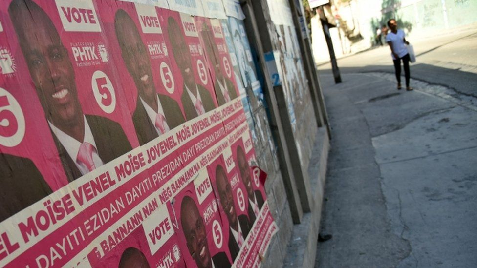 Election posters of pro-government candidate Jovenel Moise, 22 Dec 2015