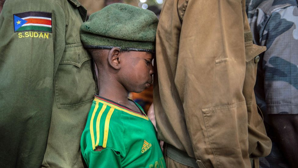 Newly released child soldiers wait in a line for their registration during the release ceremony in Yambio, South Sudan - 7 February 2018