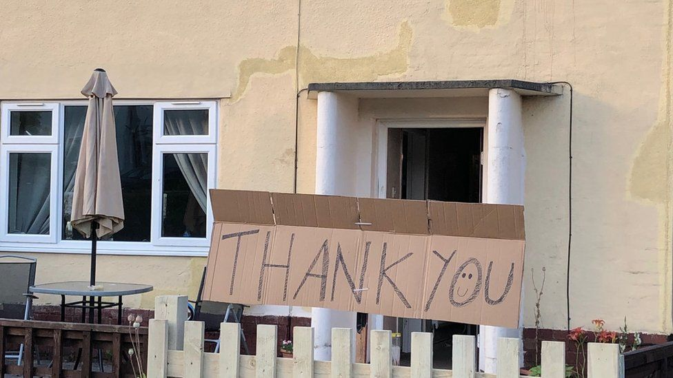 Thank you sign outside house