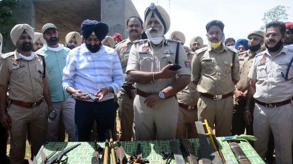 Police officers show sharp-edged weapons recovered from the arrested Nihangs in Punjab in India