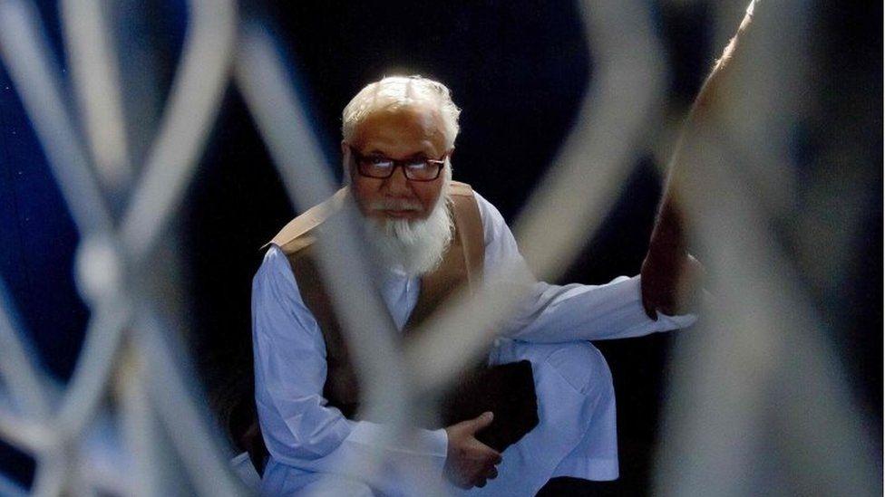 File photograph taken on October 29, 2014, shows Bangladeshi Jamaat-e-Islami party leader Motiur Rahman Nizami as he sits inside a van while being taken to a prison after being sentenced at the International Crimes Tribunal court in Dhaka. Bangladesh's Supreme Court on May 5, 2016