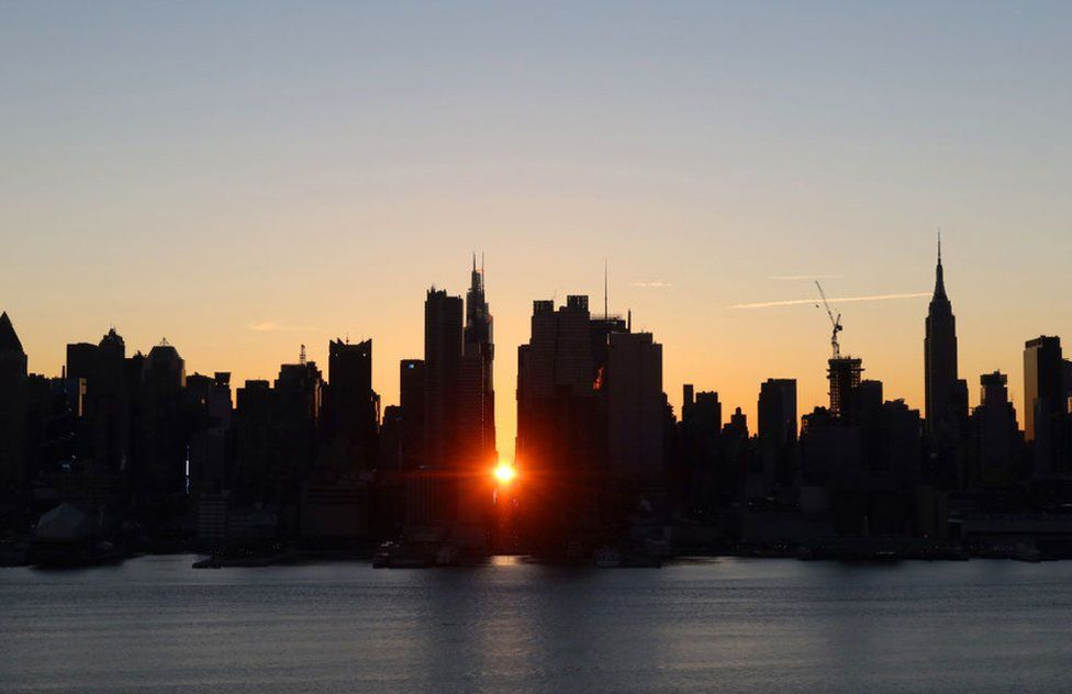 The sun rises above 42nd Street in New York City on 10 January 2021 as seen from Weehawken, New Jersey.