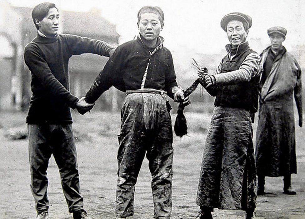 Cutting off a man's plait in China in 1912