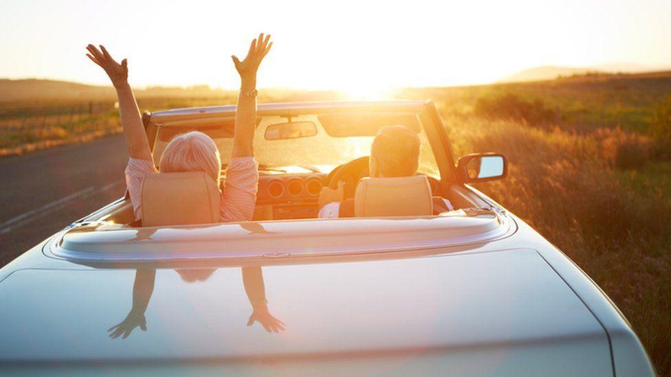 Pensioner couple in sun