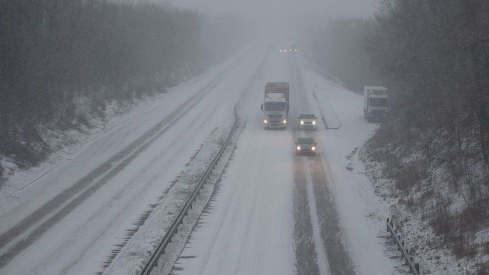 Heavy snow making driving difficult on the A4232 in Cardiff during the 'Beast from the East' storm in March 2018
