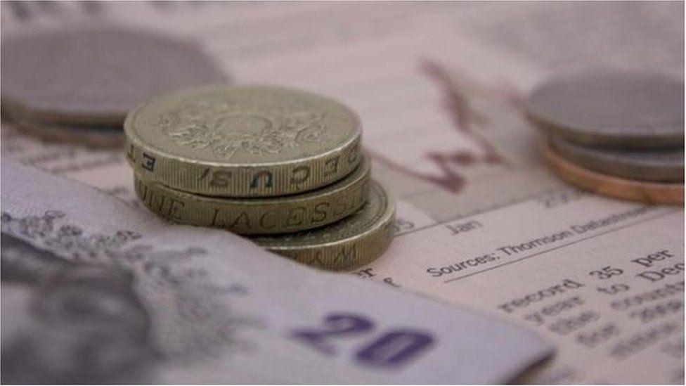 Money on newspaper