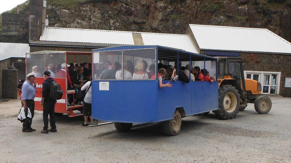"""""""Toastracks"""" used on Sark to ferry people up and down Harbour Hill"""