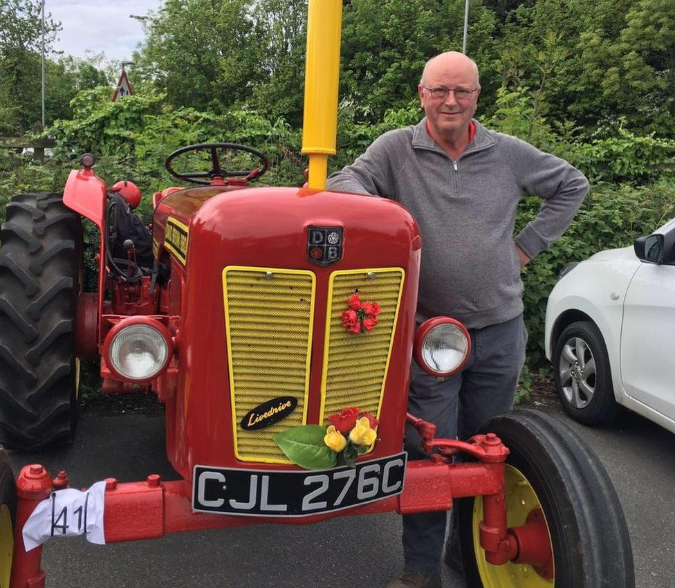 Kev Chambers standing next to a vintage tractor