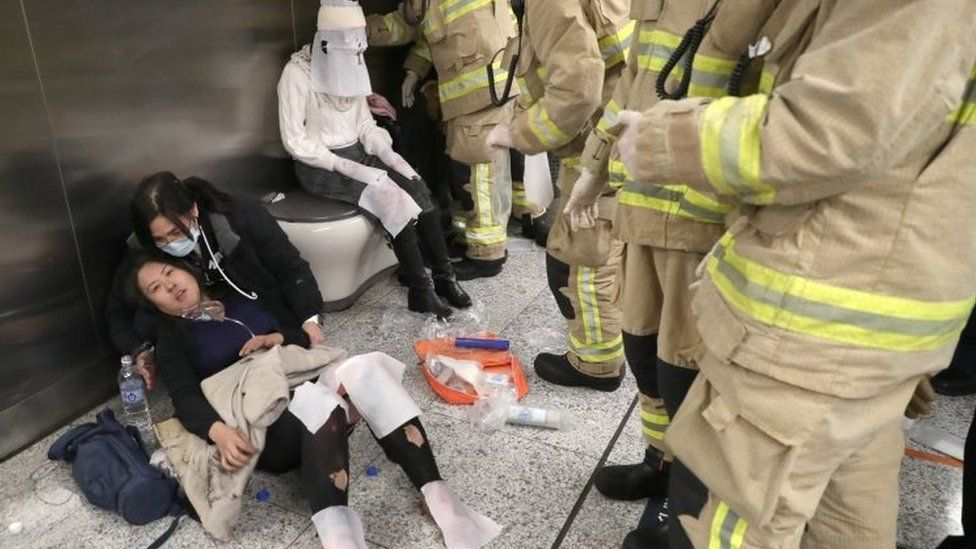 Injured people are treated at Hong Kong's underground station on 10 February 2017