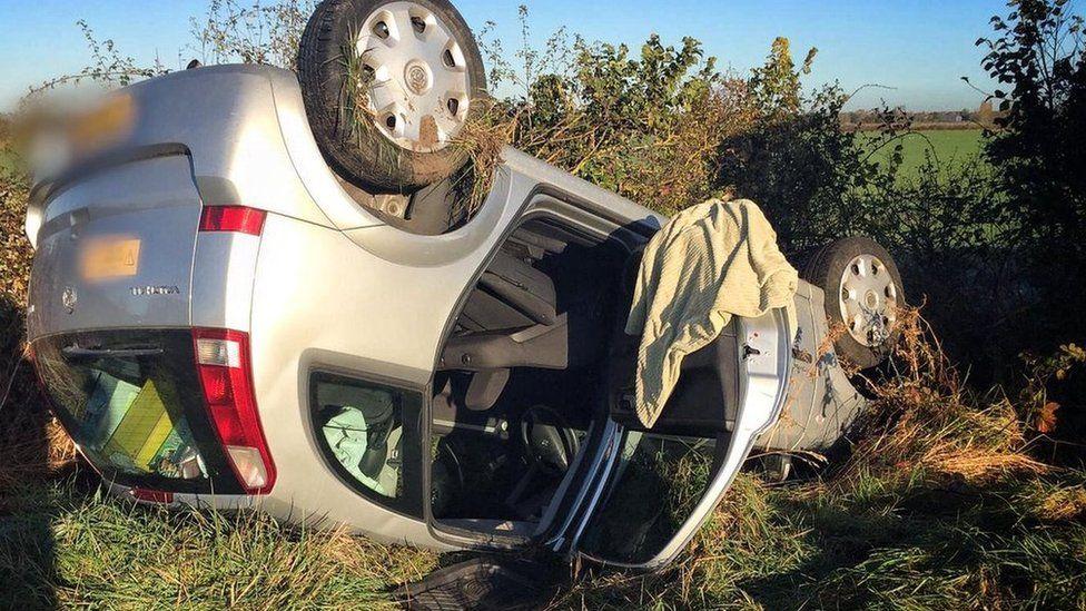 Upturned vehicle